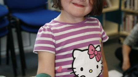 Snakes Alive at Gidea Park Library. Scarlett Marsh, 4, with a bearded dragon called Rambo, 7.