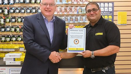 Cartridge World�'s business development manager Alan Cridge presents store manager Amit Patel with h