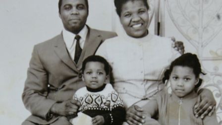 Claudia Lord-Lynch (front right) with her family, including her father, Edwin