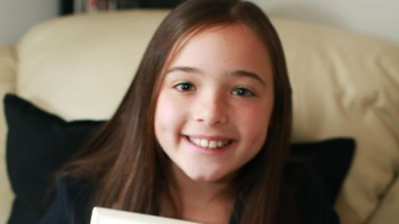 Isabella Field receives the Young Citizen Award as she raised £76,000 for Haven House Hospice.after