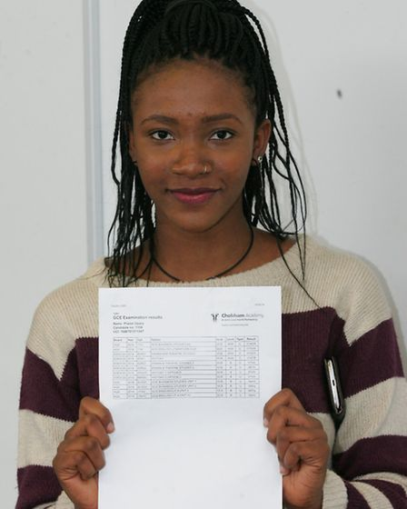 Praise Opara with her A and three B's
