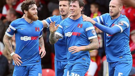 O's Darius Henderson celebrates after scoring the opener at Fleetwood Town. Pic: Simon O'Connor