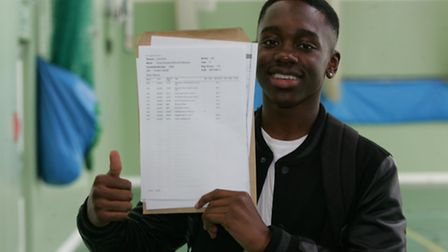 Michael Olaye-Adelaja with his results
