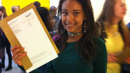 Jessica Kayode-Newman clutching her outstanding set of results