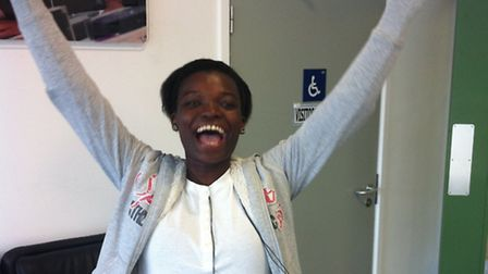 Ola Adeyemi jumping for joy at her results