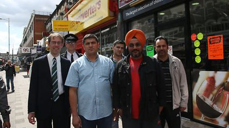 Cllr Ross Hatfull and PC Mark Hill with shopkeepers Halil Ibrahim Binboga (183 Cranbrook Road), Jagv