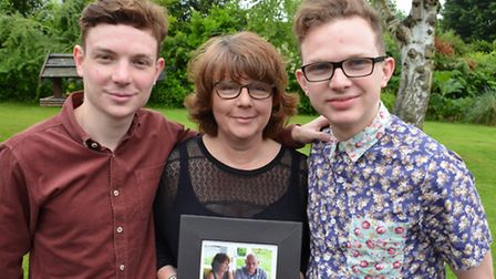 From left to right: son Jack Baxter, Gaynor Baxter (holding picture of her with husband Dave Baxter)