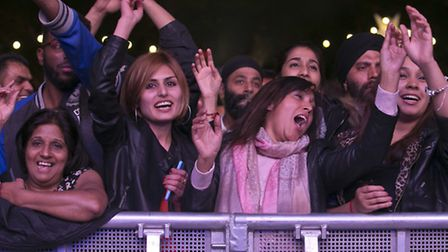 Excited fans enjoy the Bhangra beat