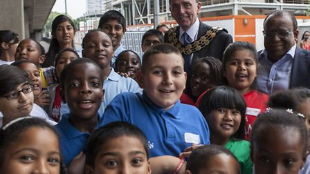 Mayor of Newham, Sir Robin Wales, and Cllr Lester Hudson, Deputy Mayor of Newham, with children who