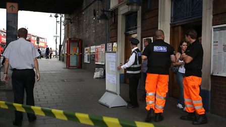 Police outside Romford train station after a death on the tracks meant that the station closed.