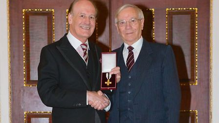 Rt Hon Lord Lingfield presenting Haven House volunteer Don Foster with the Order of Mercy. [Picture: