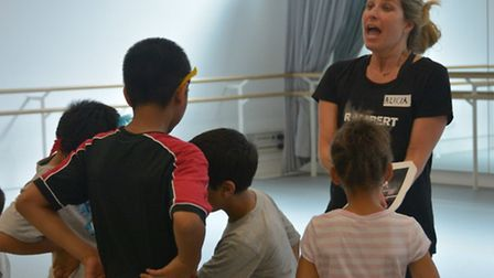 Children from Richard House hospice receive instructions from Alicia Frost from the Rambert dance gr