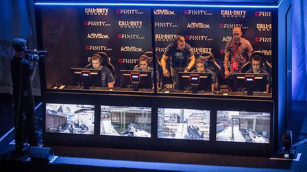 A gaming team looks serious as they compete against four other players in Call Of Duty