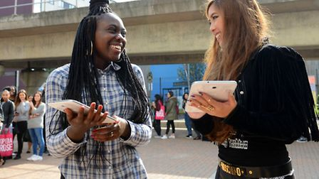 Dance students Debora Lopes De� Oliveira (left) and Peace-Sarah Emokpae inspect their new Samsung t