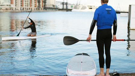 The flat, clam waters of the Royal Victoria Docks are perfect for stand up paddleboarding
