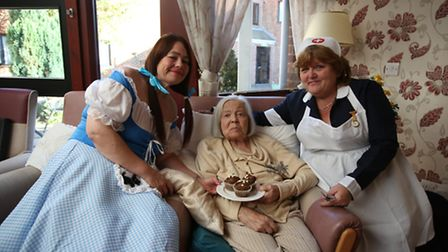 Employees Carol Kinsella and Alison Woolley at Pinewood Care Home's coffee morning with resident Dap
