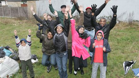 Kids and local residents jumping for joy at the play park site before work began