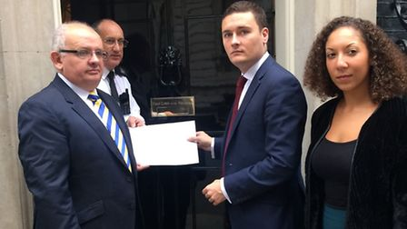 Cllr Paul Canal and Cllr Wes Streeting hand letter to David Cameron in fight to save King George Hos