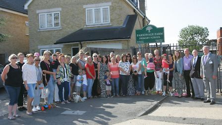 Parents and councillors protesting at the gates of Parsonage Farm School earlier this year