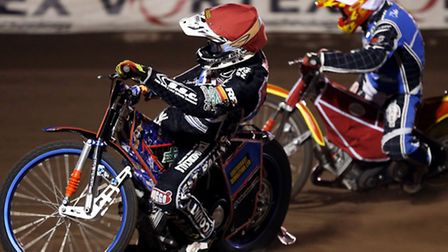 Davey Watt (red) and Vaclav Milik (white) do battle in heat five. Pic: Rob Newell/TGSPHOTO