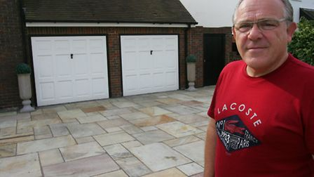 Gary Grimstead on his empty drive where his Range Rover was stolen from