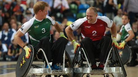 Prince Harry jostles with Mike Tindall during an exhibition wheelchair rugby match