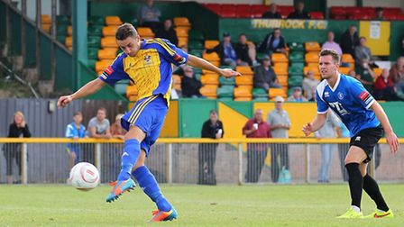Jamie Dicks scores the winning goal for Romford against Bury Town in the FA Cup (pic: Gavin Ellis/TGSPHOTO)