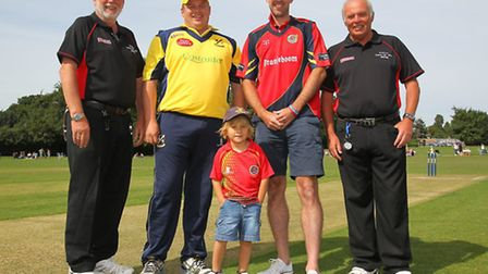 Upminster captain Ollie Peck and Essex David Masters pose with the umpires ahead of the 2013 benefit