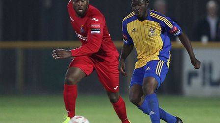 Patrick Damali, who was later sent off, battles with Abs Seymour for the ball during Romford's 2-1 w