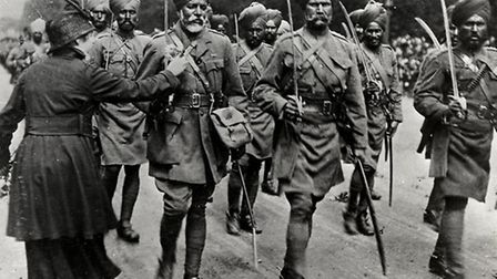 A French woman pins a flower on Sikh soldiers as they arrive in Paris in 1916 Picture: Toor Collecti