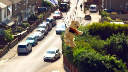 A teddy parachuting from Pakefield church tower with Saxon Road in the background at the Pakefield C
