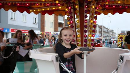 Emily Prentice, four, rides a tea cup at Saturday's event (Pictures: Ellie Hoskins)