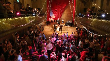 People dance in a swing ball at Wilton's Music Hall hosted by Swing Patrol London.