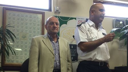 L-R: Dr Mohammed Fahim and Met Commander Mak Chishty at Friday Prayers at South Woodford Mosque. Pho