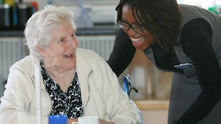 Care home manager Roda Williams with resident Sheila Newman
