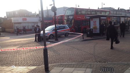 Police have cornered off an area near Romford station after a man in his 20s was seriously assaulted