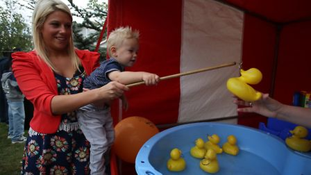 Franky Reed 1 with Amy Reed trying to catch ducks to win prized at Barts Health NHS Trust's open day
