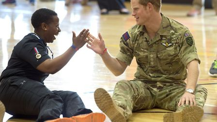 Prince Harry high-fived the former Lance Corporal when he met British soldiers competing in the Warr