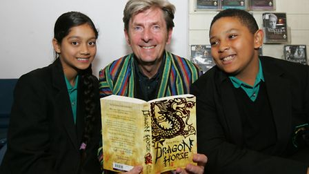 Author Peter Ward with Raina Chander, 11, and Sylva Madu, 11, at Mayfield School. [Picture: Paul Ben