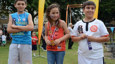 Sarah Gezgin, six, Adam Gezgin, 10, (left) and Joe Dick, 11, (right) after competing in sports at 20