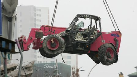 A wrecked fork lift truck is lifted from the City Gates site