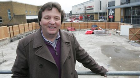 Steven Derbyshire, the pastor of the City Gates church standing in front of the site of the collaps