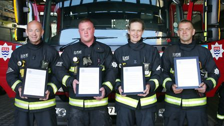 Firefighters Robert Davies, Charley Kaye, Liz Hollingsworth and Neil Friend withtheir awards