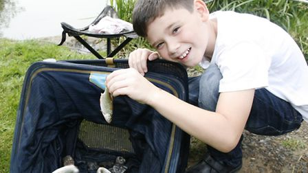 Cullen Stone, aged, nine, with his catch of the day.