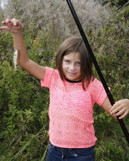 Paige Jones, eight, caught a baby perch.