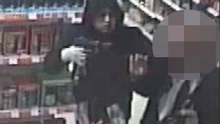 CCTV image of Jhosaim Chaudhury threatening the store's security guard. [Picture: Metropolitan Polic