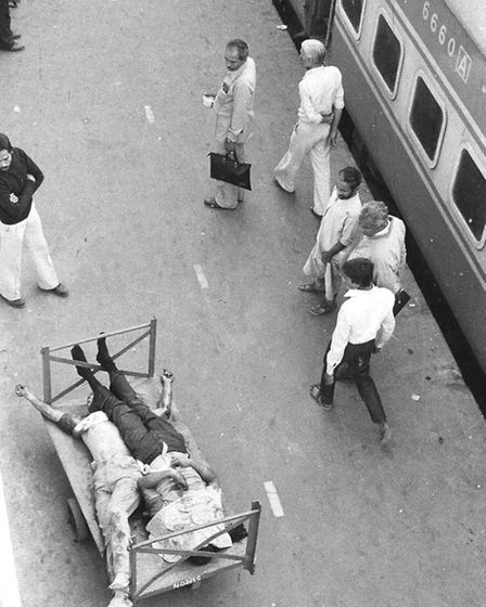 Sikhs, who were killed on trains, lie on luggage trolleys, New Delhi Railway Station - a photo from