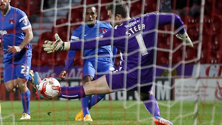 O's Jay Simpson scores past Jed Steer. Pic: Simon O'Connor