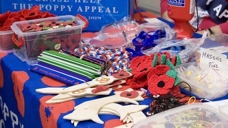 A detail of Betty Hill's poppy stall in Morrisions Stratford (photo: Arnaud Stephenson)