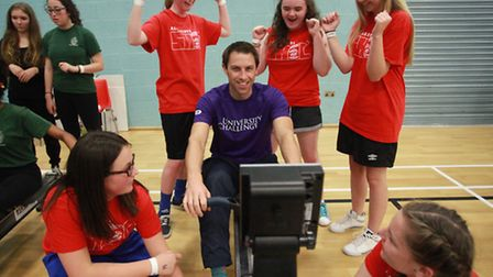 Young girls encourage Olympic medalist Mark Hunter in the Rowing Challenge at UEL Sports Dock